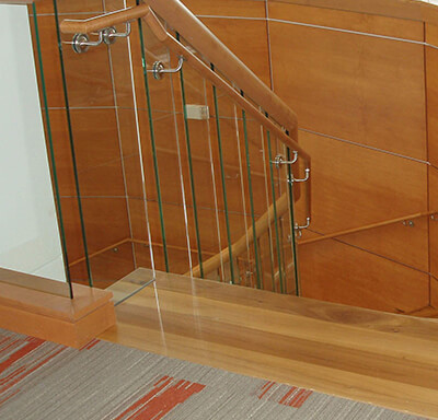 Curved wood encased stair rail well